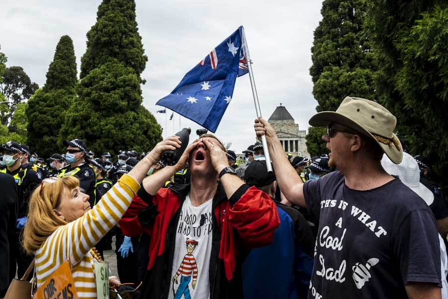 Melbourne 23/10/2020, protesters help a man who was pepper sprayed by Police officers at the Shrine of Remembrance, during the demonstration Anti-Lockdown.