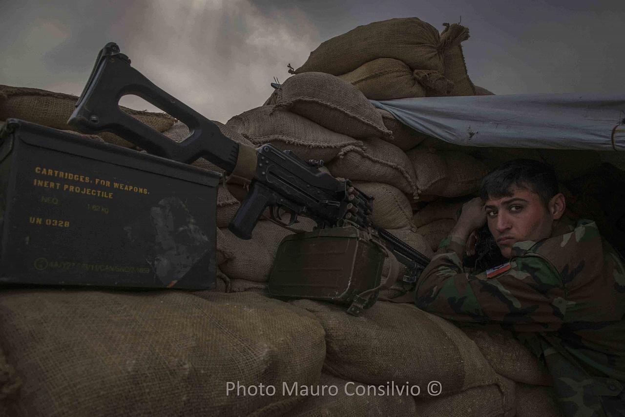Iraq Bashiqa. PAK soldier Peshmerga on the mountain in the first fighting line of Bashiqa. - Kurdistan Iraq Bashiqa. PAK soldier Peshmerga on the mountain in the first fighting line of Bashiqa.